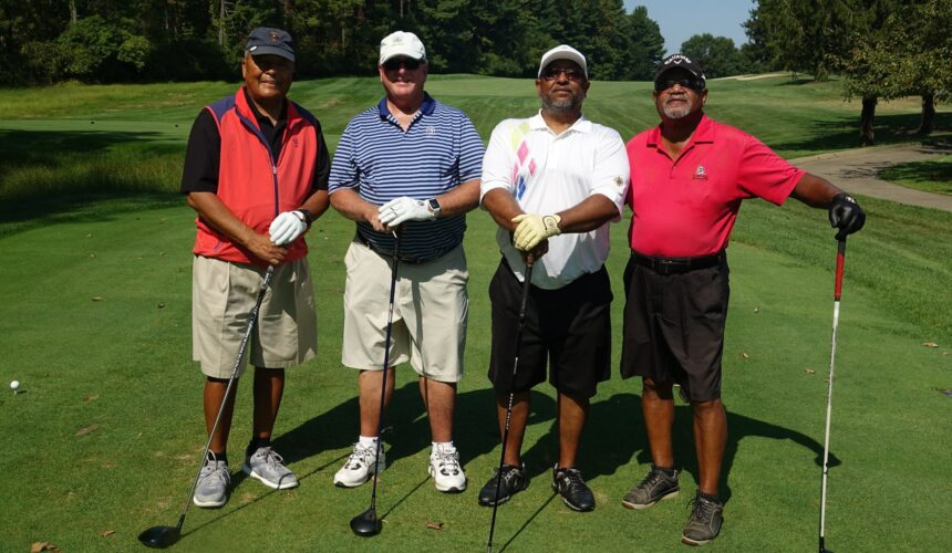 Four Men with golf clubs