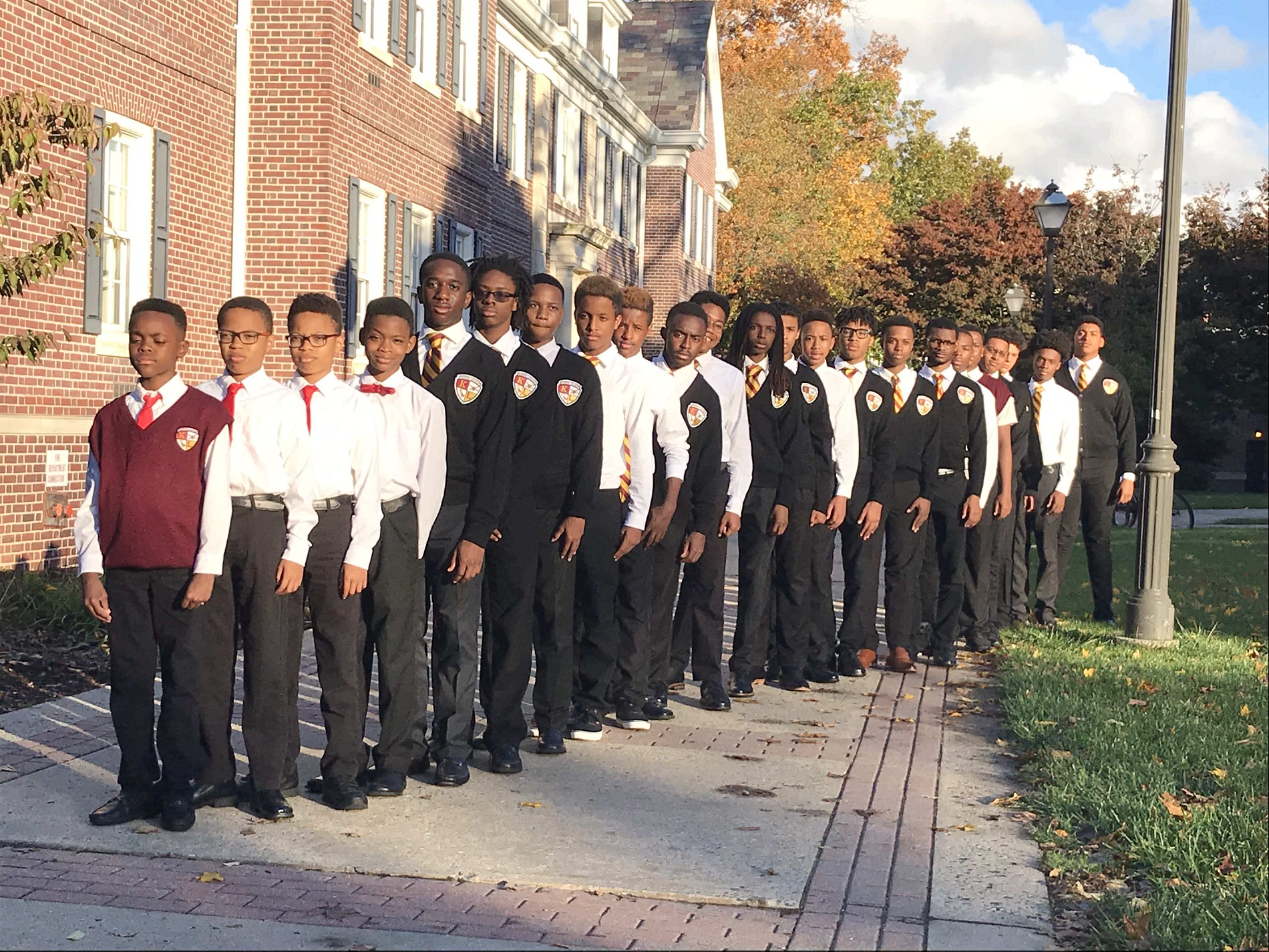 Kappa League Young men standing in a line