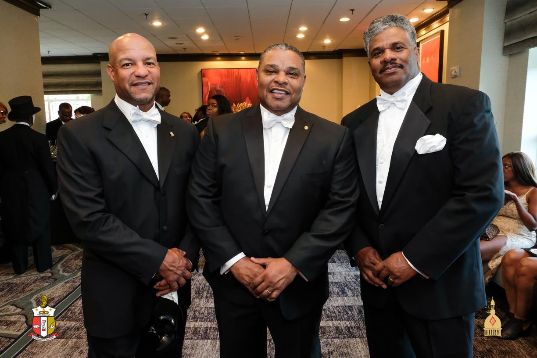 Three Men standing in Tuxedos