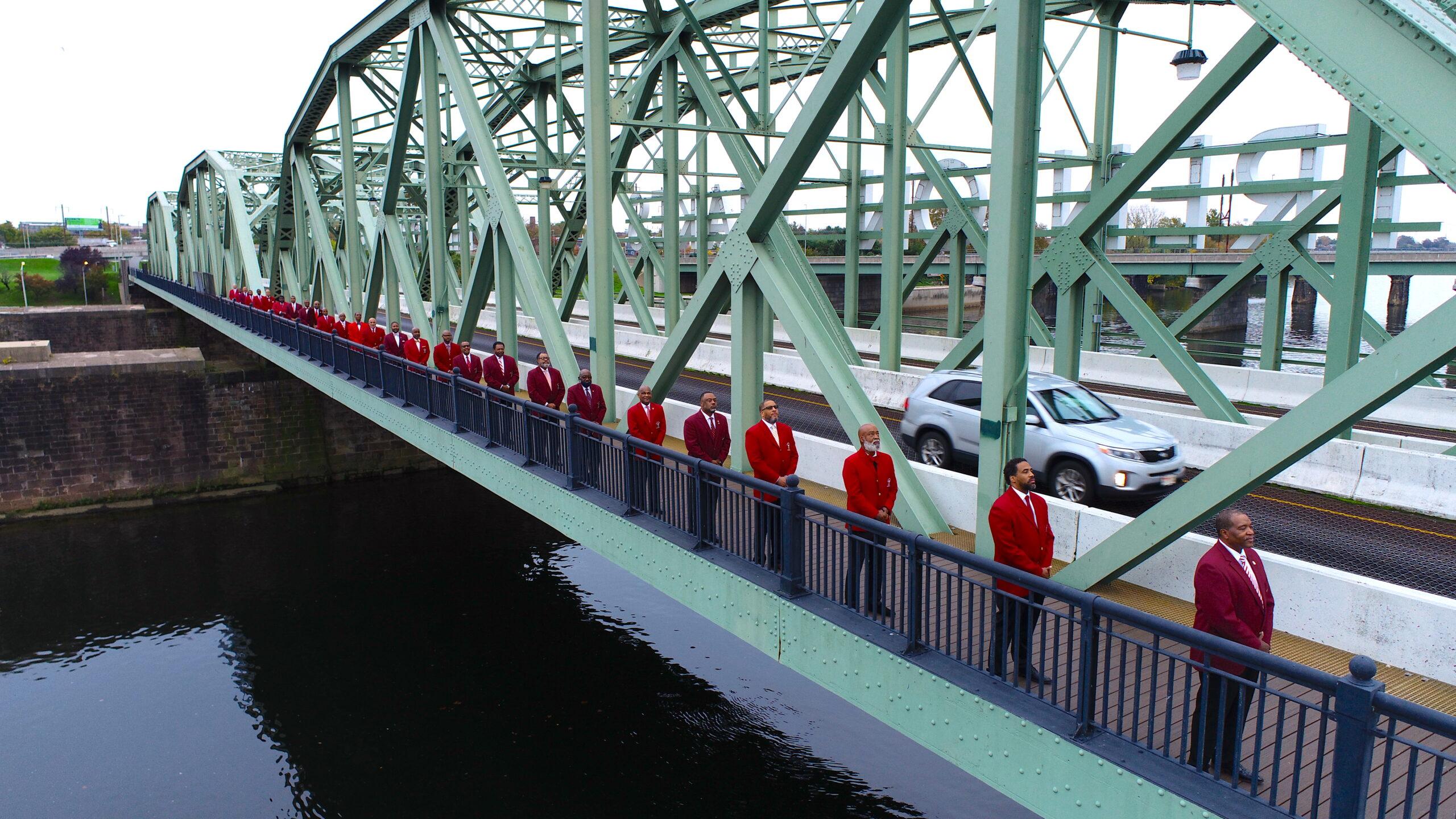 Photo of Men lined up across Tretnon Makes Bridge