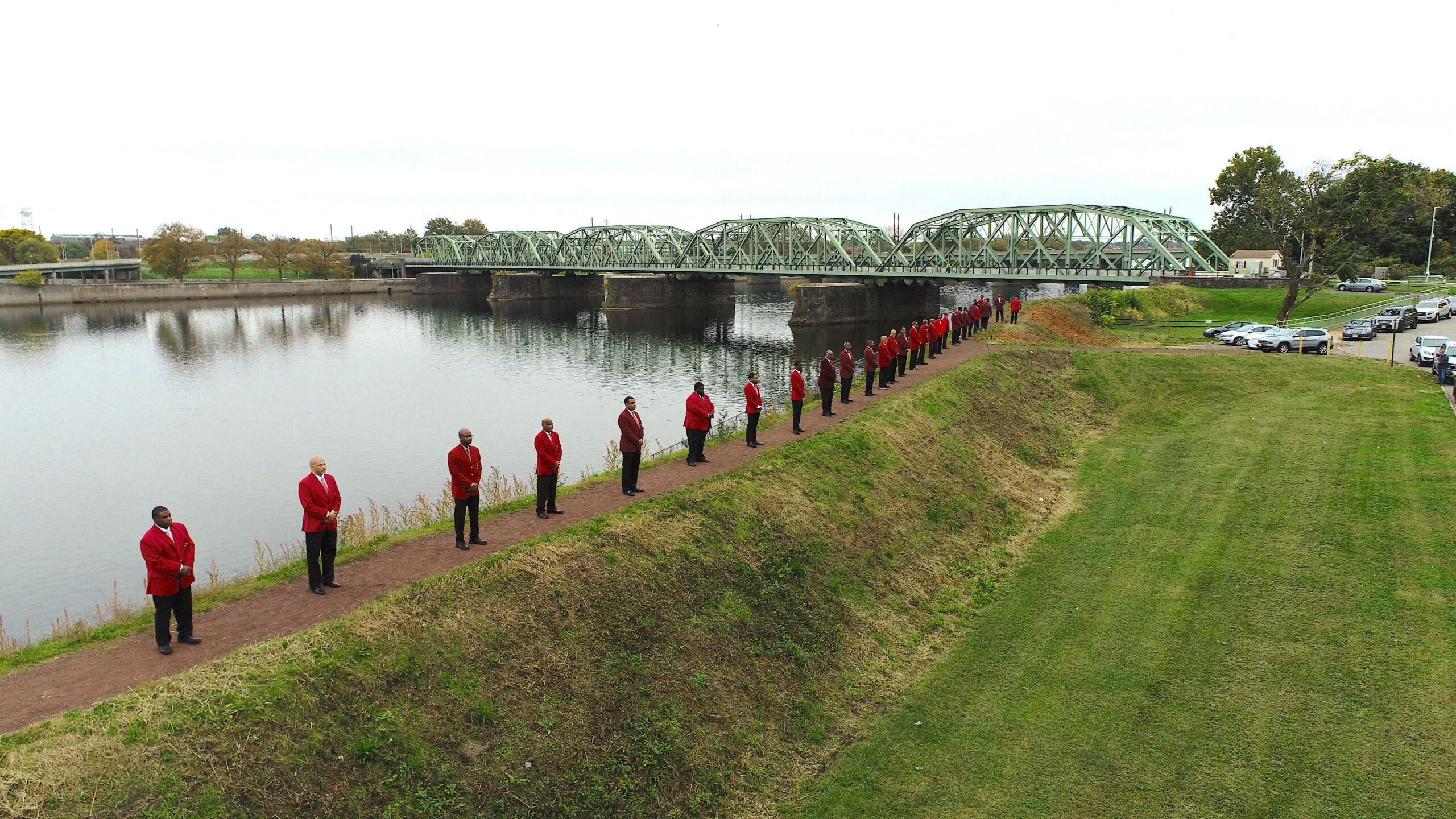 Photo of men lined up along Delaware River